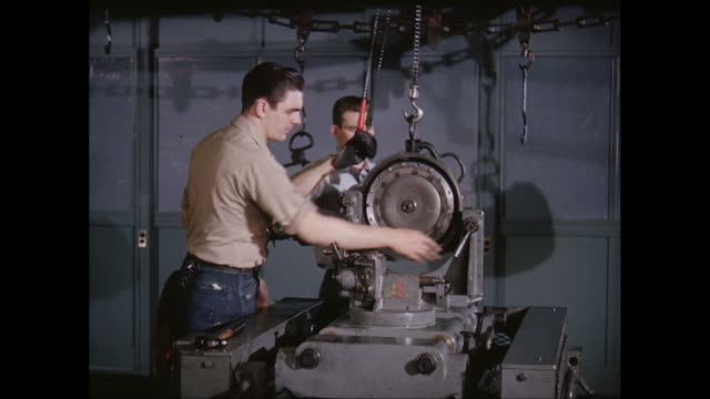 ms man operating machine in factory / united states - jeans video stock e b–roll