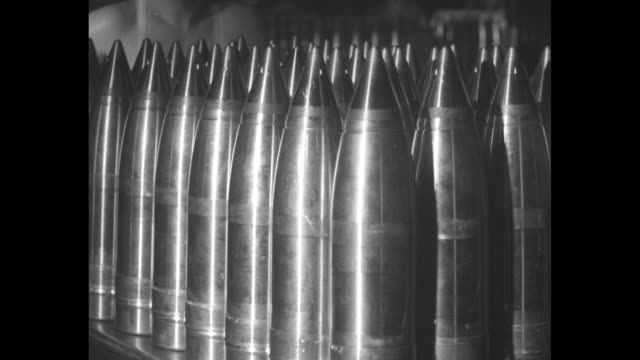 man operating machine used in process of making shells / man measuring shells with gauge to make sure they meet specifications / three shots of men... - ammunition stock videos & royalty-free footage