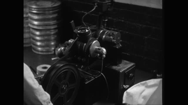 CU Man operating machinery while manufacturing film reel / United States