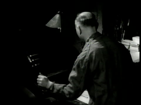 vidéos et rushes de dramatization night man operating printing press checking printed page cu front page of 'combat' underground newspaper wwii - world war 1