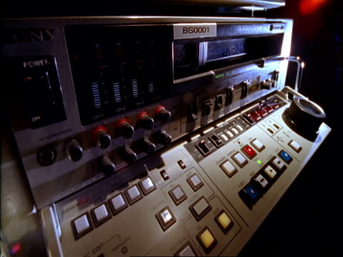 cu, man operating video tape deck - film editing stock videos & royalty-free footage