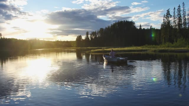 man out rowing on a summer evening - rowing stock videos & royalty-free footage