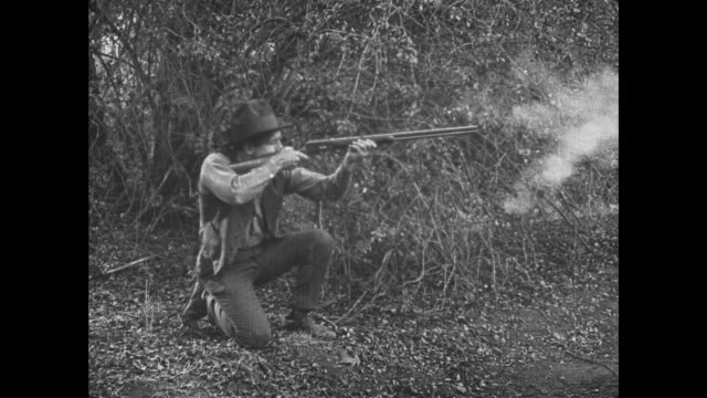 1921 man outdoors aims and shoots at fake ghost inside house - 1921 stock videos & royalty-free footage