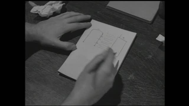 man pacing around inside the laboratory, writes diagram down on notebooks and smiles behind the desk - 1940 1949 bildbanksvideor och videomaterial från bakom kulisserna