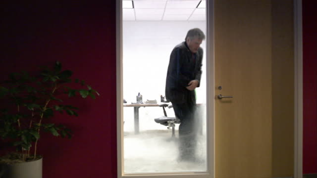 man pacing back and forth and shivering inside frozen office - shivering stock videos & royalty-free footage