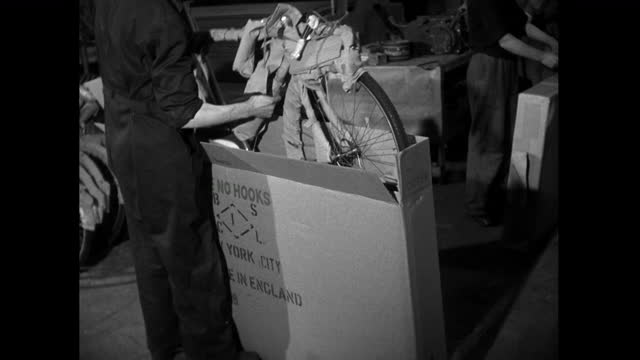 man packs finished bicycle into box in factory; 1952 - production line worker stock videos & royalty-free footage