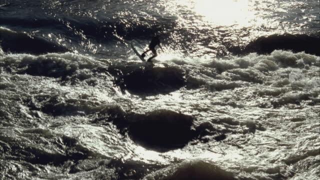 slo mo ws zi man paddle-boarding through waves in river / aspen, colorado, usa - balance stock videos & royalty-free footage