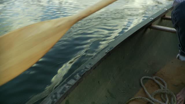 cu tu man paddling canoe on lake, morristown, vermont, usa - vermont stock videos & royalty-free footage