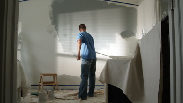 man painting a bedroom - see other clips from this shoot 1418 stock videos & royalty-free footage