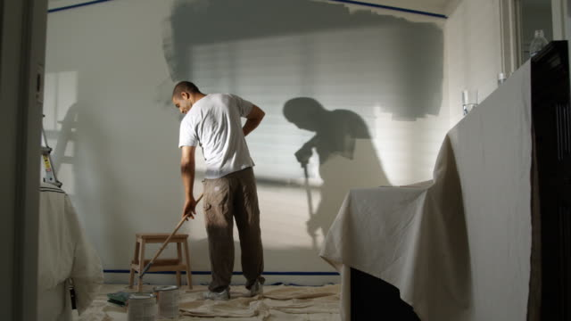 man painting a bedroom - see other clips from this shoot 1419 stock videos & royalty-free footage