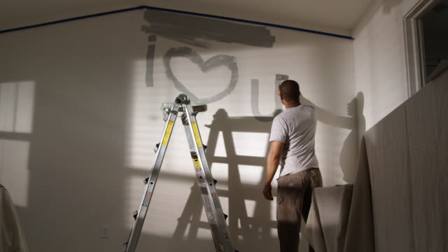 man painting i love you on the wall - see other clips from this shoot 1419 stock videos & royalty-free footage