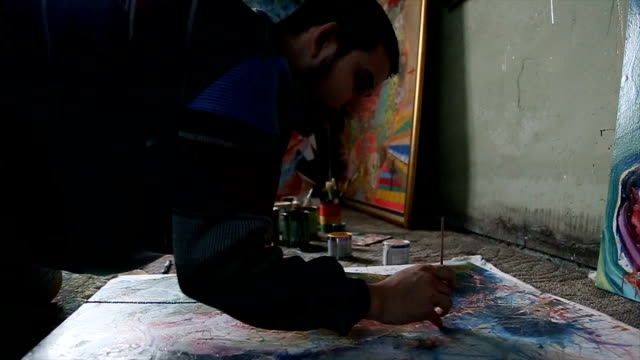 man painting on studio floor - atelier tent stock videos and b-roll footage