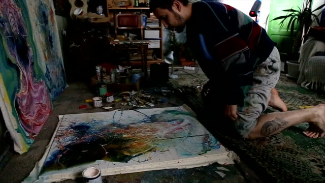man painting on the floor - atelier tent stock videos and b-roll footage