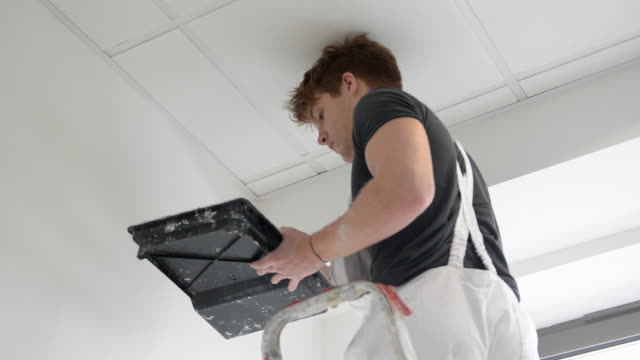 ms man painting wall / london, england, united kingdom - professional painter stock videos and b-roll footage