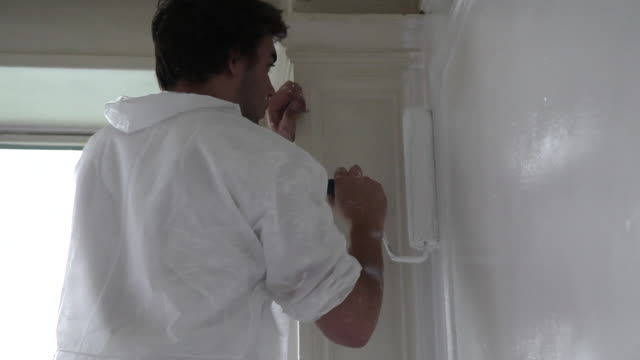 man painting wall - professional painter stock videos and b-roll footage