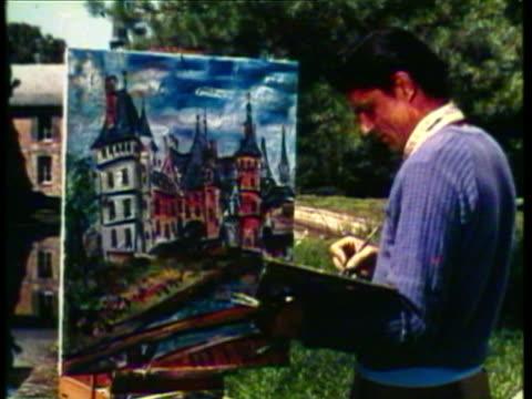 vídeos y material grabado en eventos de stock de 1953 ws ms man paints picture of the chateau's reflected in pool / france / audio - caballete equipo de arte y artesanía