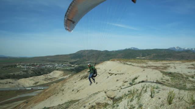 ws pan pov man paragliding over mountain / lehi, utah, usa. - lehi stock videos & royalty-free footage