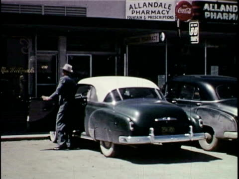 man parking car, putting belongings in truck, and locking doors - 1953 stock videos and b-roll footage