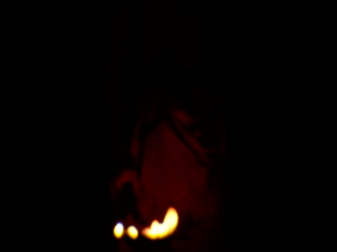 man partially lit by flame light carries ladle of hot flames bombay - ladle stock videos & royalty-free footage
