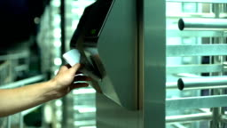 Man passing electronic turnstile, access control for business center, closeup