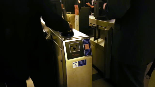 man passing through fare gate in london underground station - ticket stock videos & royalty-free footage