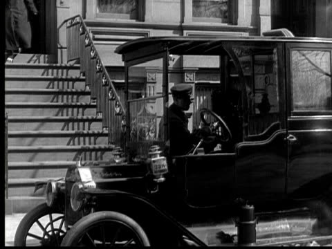 b/w, ms, man paying cab driver in front of house, 1924 - 1924 stock videos and b-roll footage