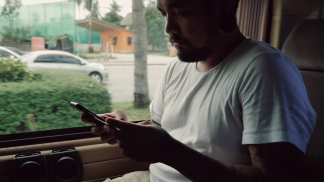 A man paying online using a smart phone.