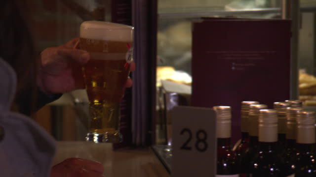 a man pays for a pint of lager with cash at a central london bar, uk. - pint glass stock videos & royalty-free footage