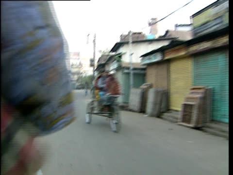 a man pedals a bike through the streets of bangladesh - bangladesh stock videos & royalty-free footage