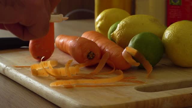 man peeling carrots with carrot peeler - peel stock videos & royalty-free footage