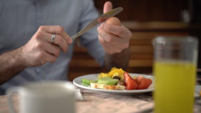 man peeling off hard-boiled egg - hard boiled egg stock videos & royalty-free footage