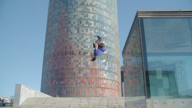 man performing backflip parkour style in barcelona  - sport concepts - steps and staircases stock videos & royalty-free footage