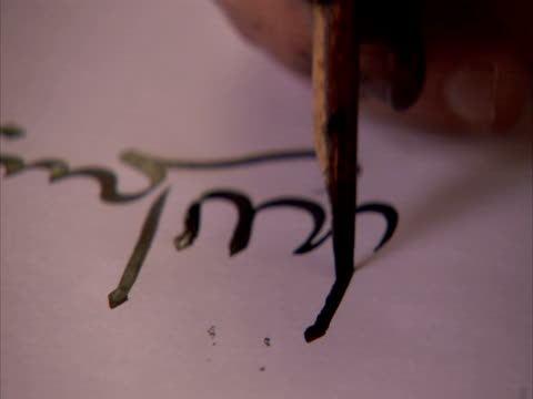 CU, man performing calligraphy, Syria (sound available)