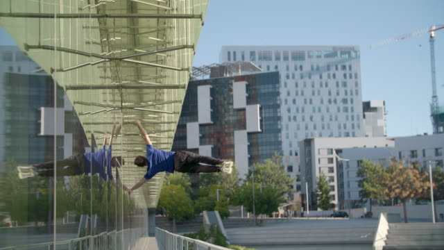 man performing human flag parkour calisthenics outdoors - sport concepts - aufführung stock-videos und b-roll-filmmaterial
