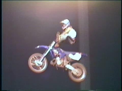 ms, pan, man performing jump off ramp on motorbike then crashing, usa - helmet stock videos & royalty-free footage