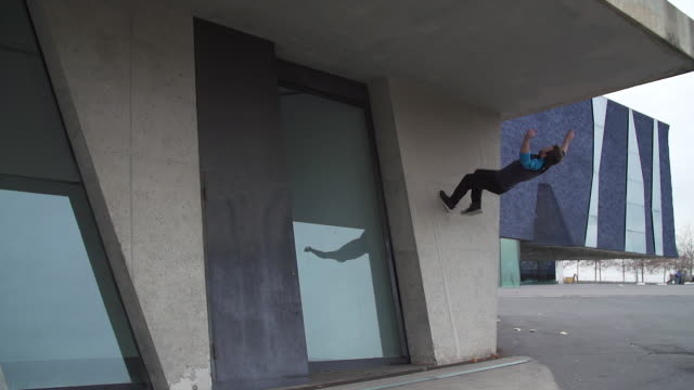 Man performing parkour style backflip - Sport Concepts