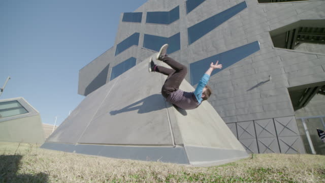 Man performing parkour style somersault - Sport Concepts