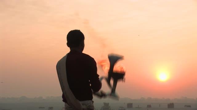 ms, man performing puja ritual at sunrise, rear view, varanasi, uttar pradesh, india - ceremony stock videos & royalty-free footage