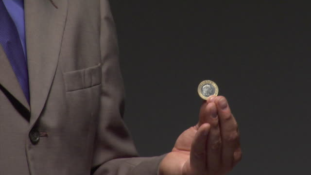 CU Man performing tricks with coin