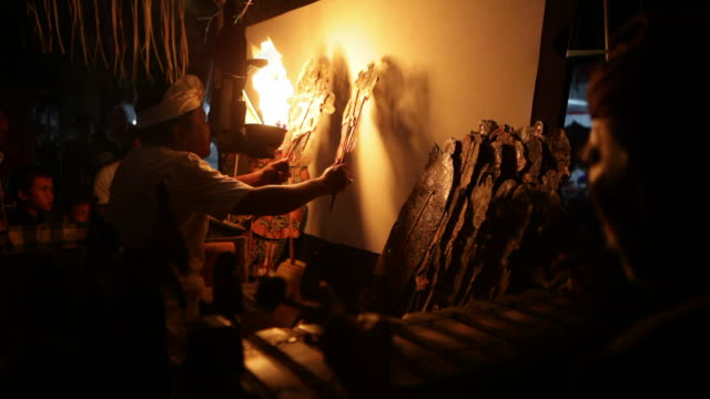 ms man performing wayang kulit in shadow puppet theatre, tejakula, bali, indonesia - puppentheater figur stock-videos und b-roll-filmmaterial