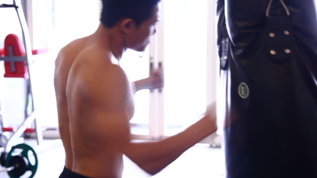 man performs exercise - boxing - human limb stock videos & royalty-free footage