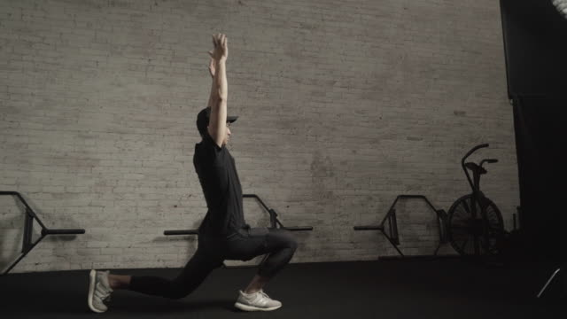 man performs lunges inside health club - lunge stock videos & royalty-free footage