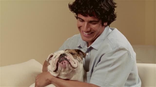 CU, Man petting English bulldog, portrait