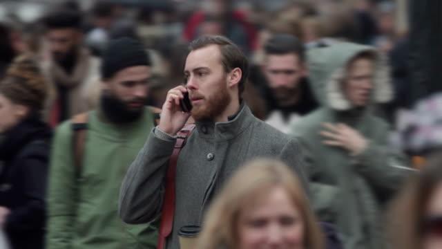 Man phone crowd