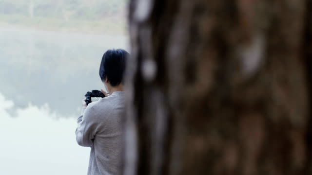 man photographer taking photograph in beautiful nature - mae hong son province stock videos and b-roll footage