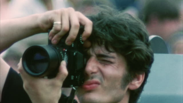 cu man photographing at woodstock festival / bethel, new york, usa - photographic equipment stock videos & royalty-free footage