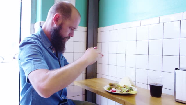 man photographing food in restaurant - mexican restaurant stock videos & royalty-free footage