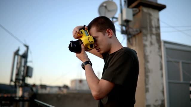 man photographing from the roof - photographer stock videos & royalty-free footage
