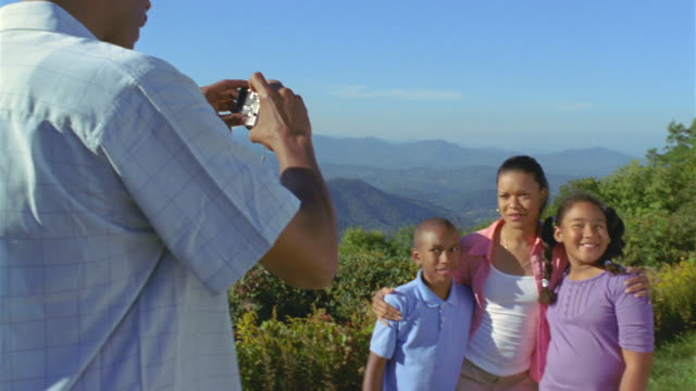 ms pan man photographing his family against mountainous landscape / asheville, north carolina, usa - see other clips from this shoot 31 stock videos & royalty-free footage