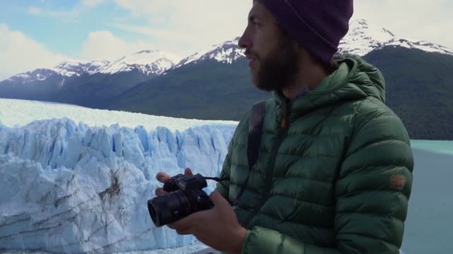 man photographing  scenic view of perito moreno glacier in patagonia - unesco world heritage site stock videos & royalty-free footage
